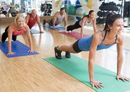 Instructor Taking Exercise Class At Gym